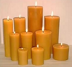 A group of beeswax pillar candles
