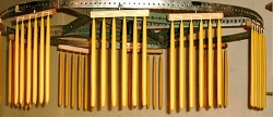 beeswax taper candles hanging on a rack